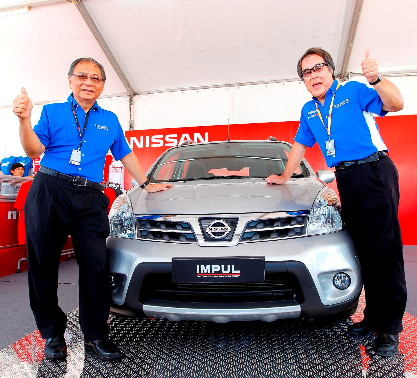 Dato' Dr. Ang Bon Beng & Mr.  Kazuyoshi Hoshino posed in front of the Nissan Livina X-Gear Tuned by  IMPUL.